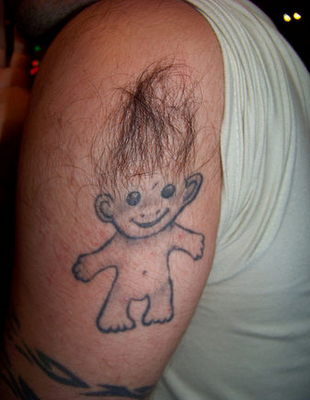 creative use of body hair for this tattoo