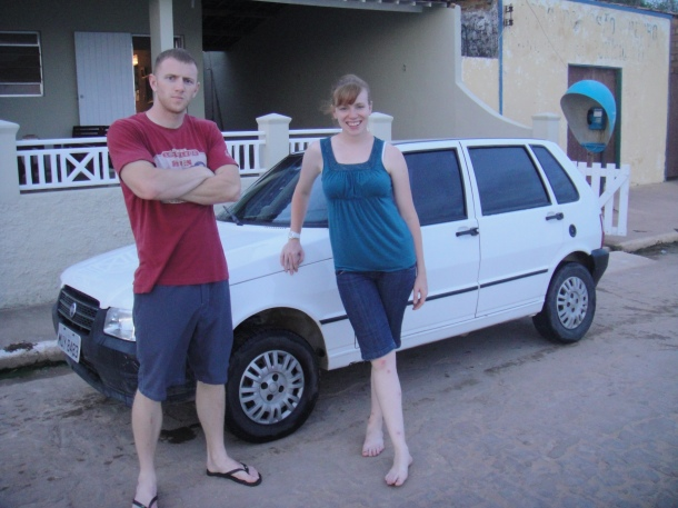 Brandon and Amanda Boers posing next to the mighty Fiatrarri