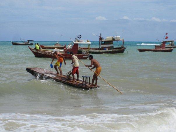 Fishermen going out to sea in Lagoa Azeda, Brazil