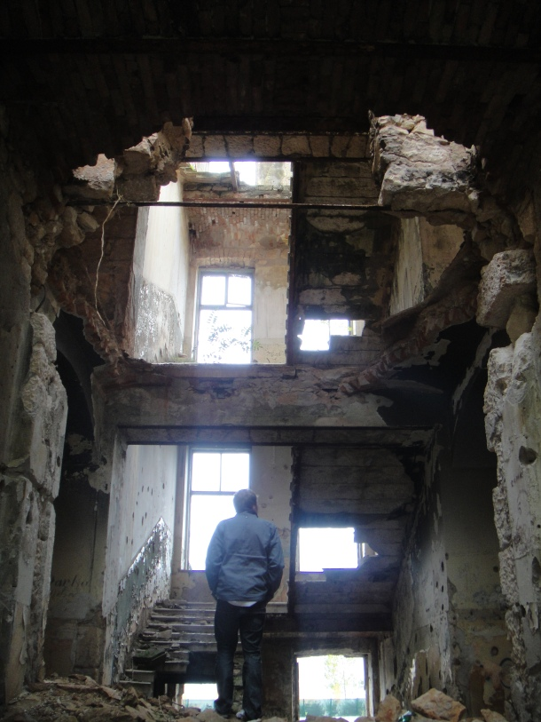 Andrew Drury surveying war damage in Mostar, Bosnia