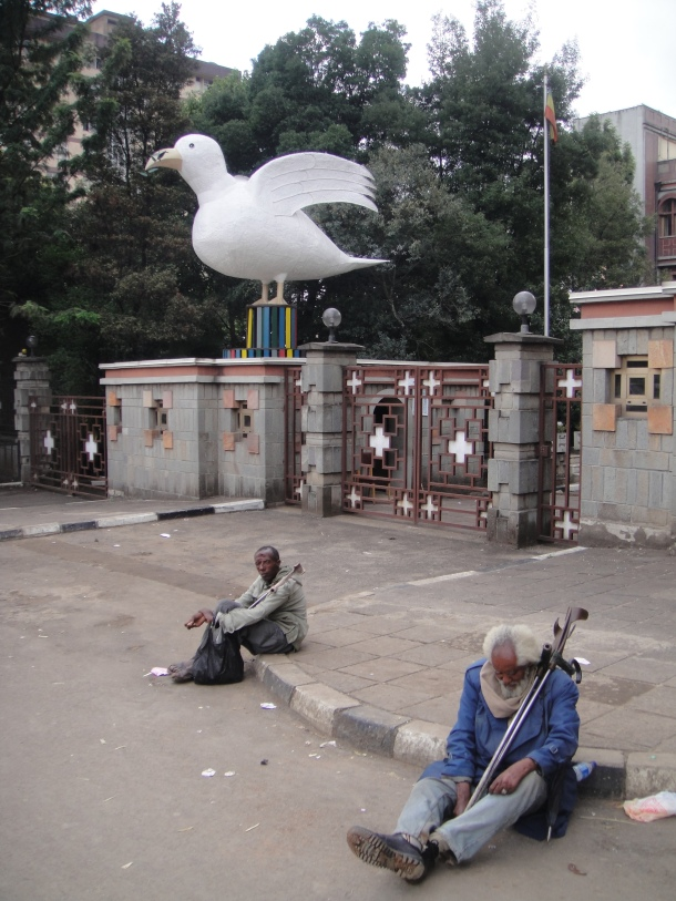 Beggars and doves in Addis Ababa