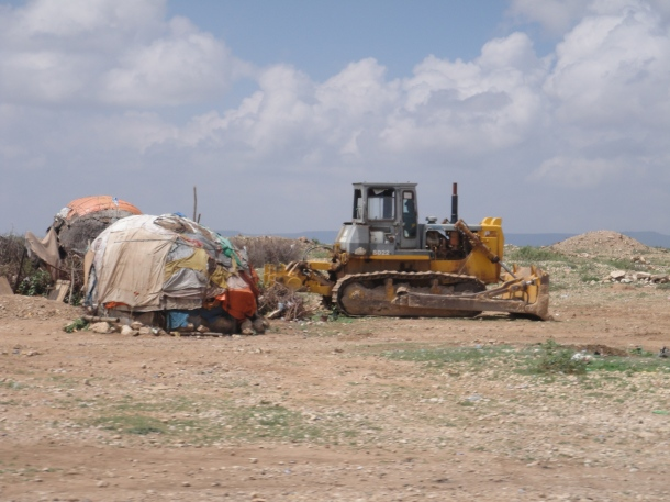 hut next to bulldozer in jijiga