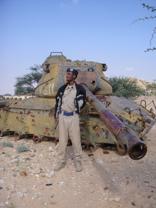 Our guard posing next to the wreck of a somali tank
