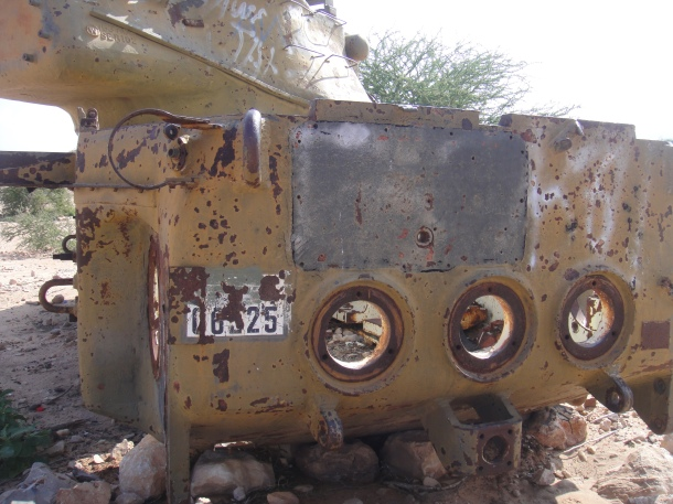 Plate for a bombed out tank in Somalia
