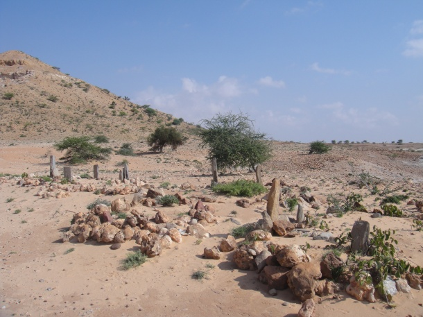 Graveyard next to bombed out Somali tank