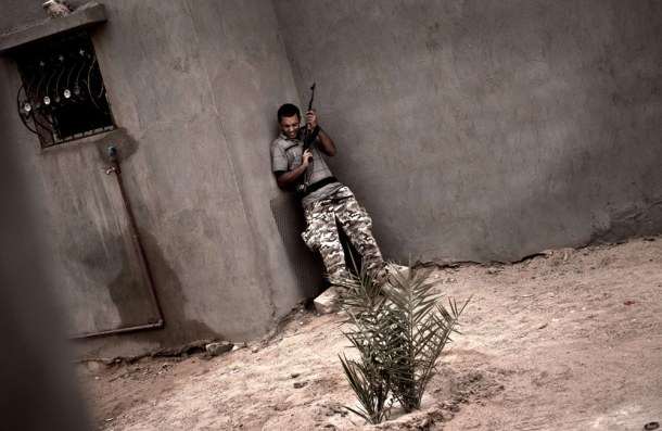 libyan-rebel-under-fire-josh-village