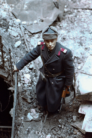 romanian officer standing in rubble