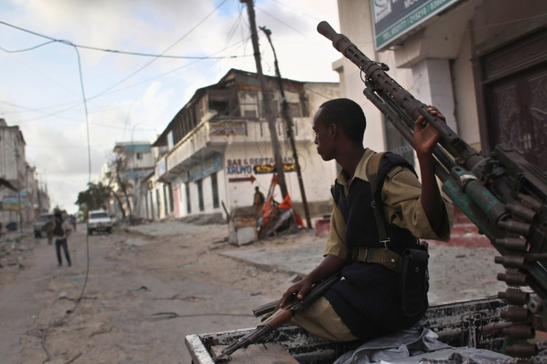 government militiaman sits on a pickup truck-mounted anti-aircraft gun in mogadishus Bakara market
