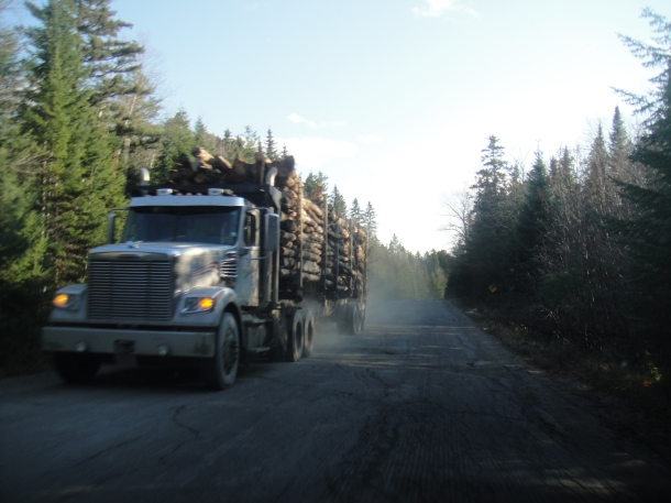 log truck golden road maine