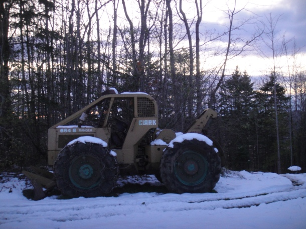 skidder with snow chains