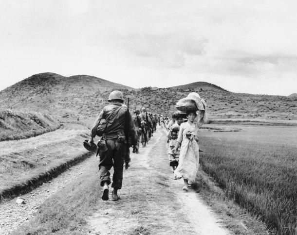 americans-passing-refugees-korean-war