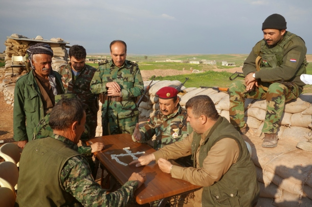 Commander-sarhad-betwata-takes-the-time-to-have-fun-with-his-fighters-in-order-to-keep-morale-up-as-they-await-the-order-to-invade-mosul