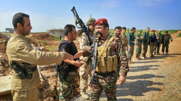 kurdish-peshmerga-fighters-gather-in-formation-to-greet-visiting-officer