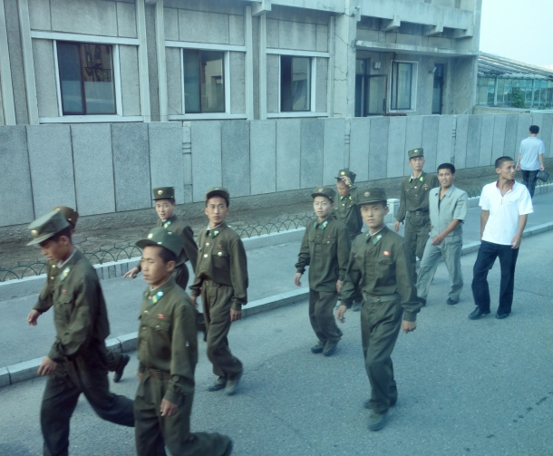Despite the tremendous cost, North Korea has one of the largest militaries in the world when measured by the number of active-duty soldiers (and the largest paramilitary force in the world, representing 25% of the population).  As such, one frequently sees more soldiers than civilians when traveling through North Korea.