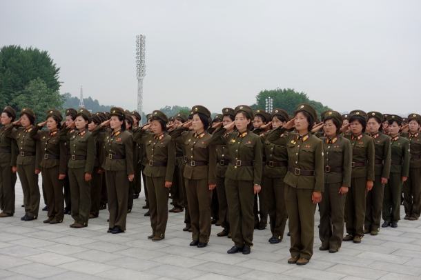 North Korean soldiers salute statues of the country's two previous dictators from the Kim family, Kim Il-sung and Kim Jong-Il